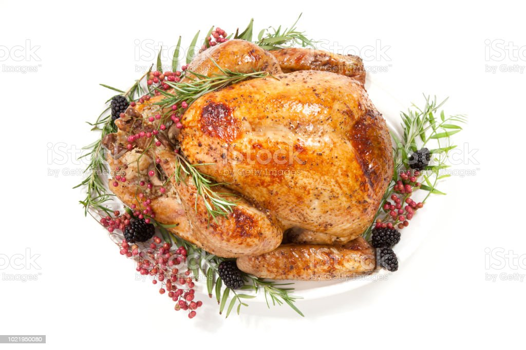 Thanksgiving pepper roasted turkey garnished with blackberry and pink...