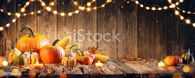 istock Thanksgiving With Pumpkins And Corncob On Wooden Table 1027365226