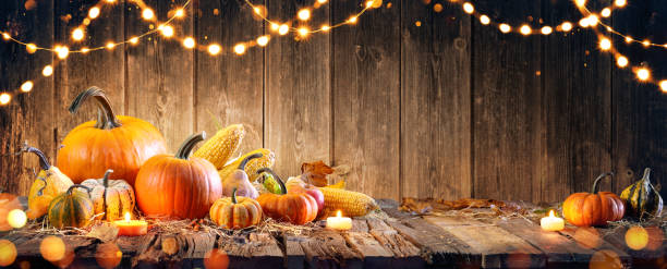 thanksgiving with pumpkins and corncob on wooden table - thanksgiving стоковые фото и изображения