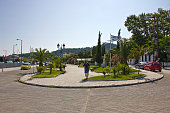 Kavalla, Greece - July 15, 2019: View of  Thassos which is a north Greek island in july summer. There are many monuments and statue in island. You see Pontian Helenizm monument or Sculpture of a mermaid on the small harbour on Thassos island.