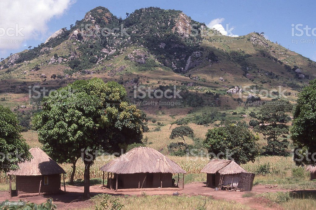 Thatch Roof Huts and farmland rocky hills Togo West Africa stock photo