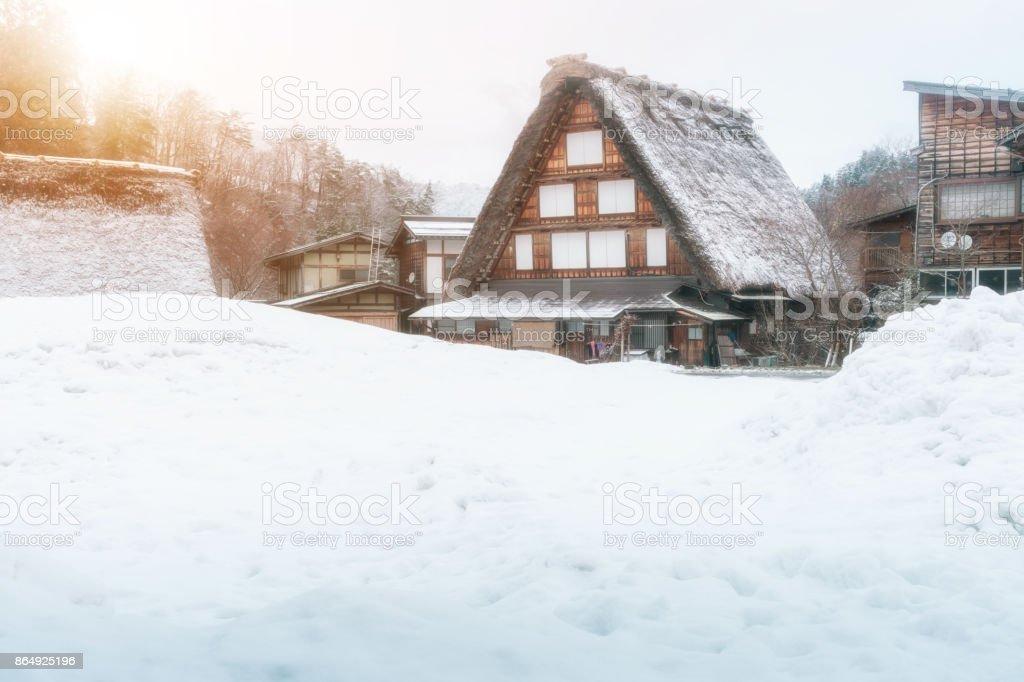 Thatch roof traditional style house with sun light, Historic village Shirakawago in winter season, Japan stock photo