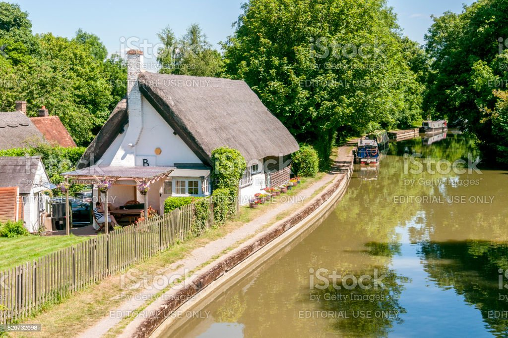 Thatched cottage by the Marsworth canal stock photo