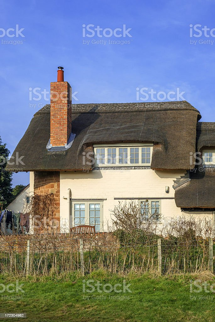 thatched cottage stock photo