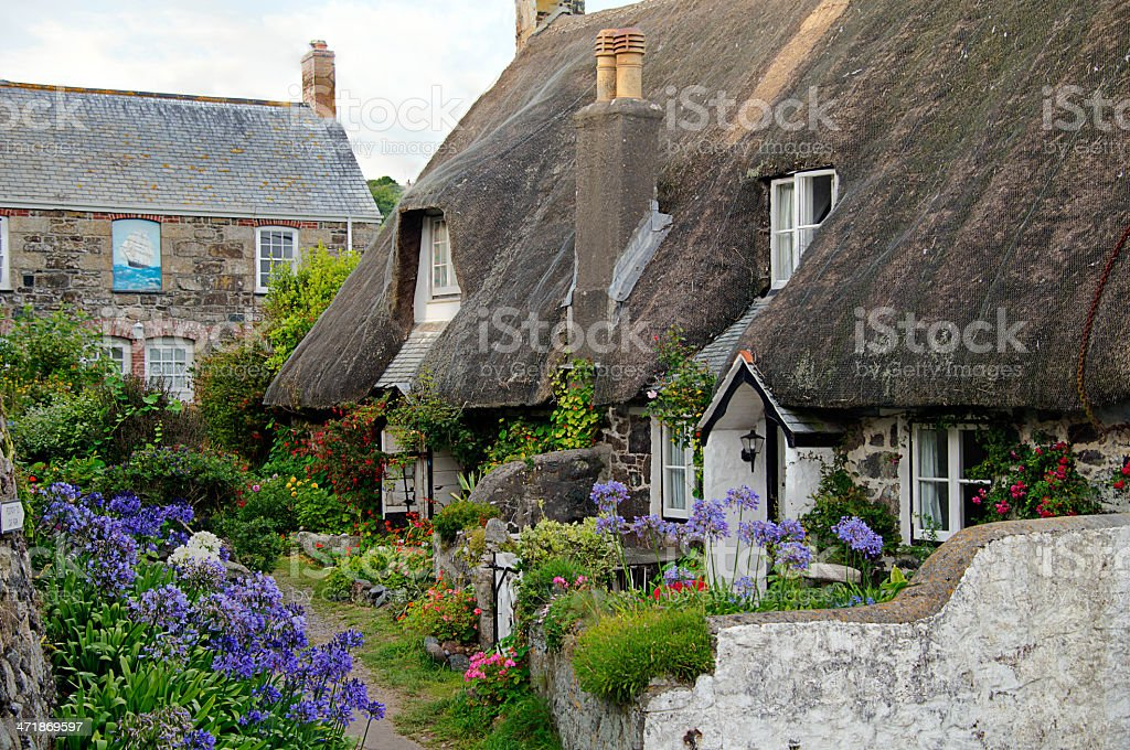Thatched fishermans cottage and beautiful gardens stock photo