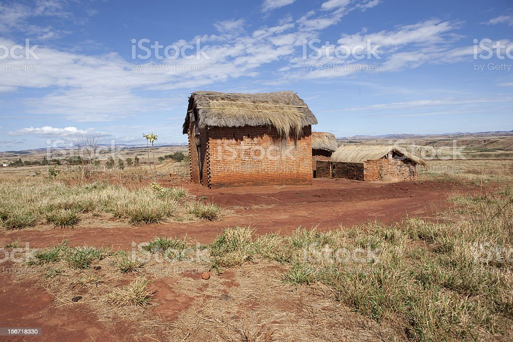 Thatched house in Western Madagascar stock photo