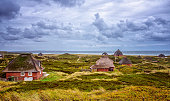 istock Thatched Houses in the dunes of Hörnum (Sylt) 520409819