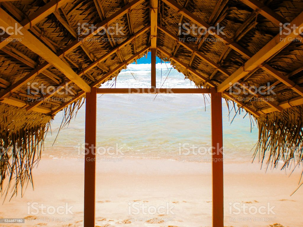 Thatched roof beach stock photo