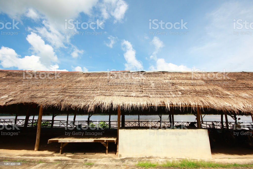 Thatched Roof of local Souvenir shop in market at countryside in Thailand. Asian urban house style with blue sky. stock photo