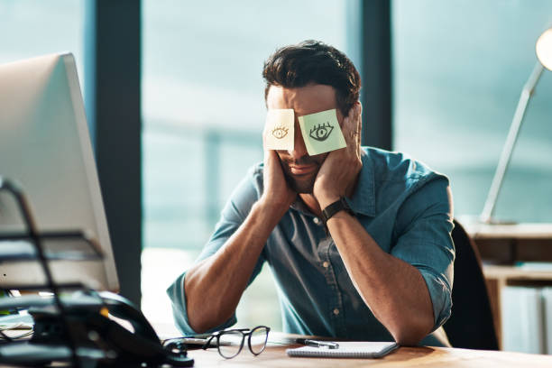 That's it, I'm done Shot of a tired young businessman working at his desk with adhesive notes covering his eyes mental burnout stock pictures, royalty-free photos & images