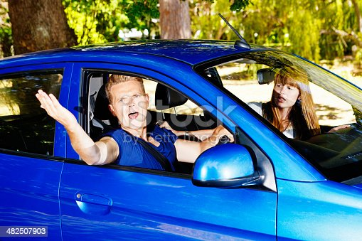 475395935istockphoto That's my parking space! Exasperated driver gestures angrily 482507903
