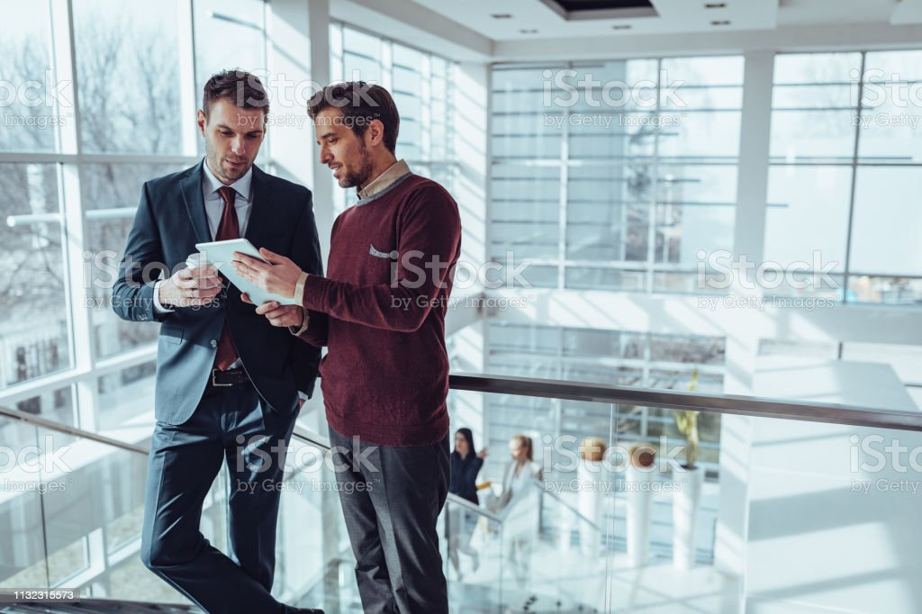 That's one productive coffee date Business people using technology during their office break Adult Stock Photo