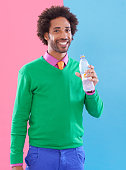 Shot of a stylish young man drinking from a bottle against a colorful backgroundhttp://195.154.178.81/DATA/i_collage/pi/shoots/783402.jpg