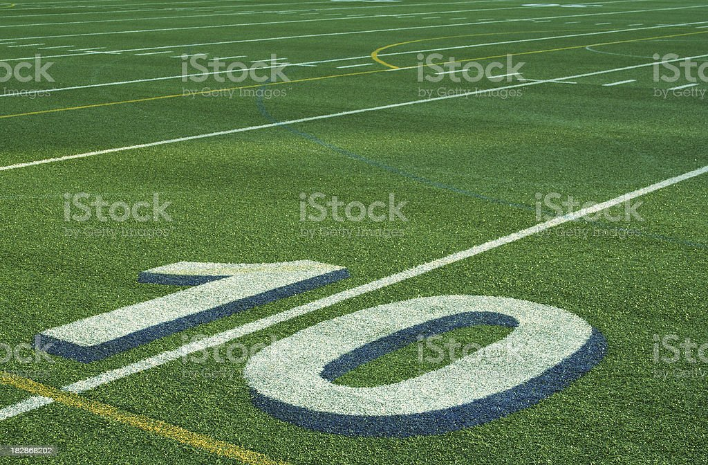 The 10 Yard Line on an Astroturf Football Field Background royalty-free stock photo