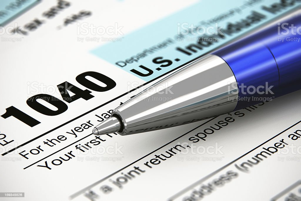The 1040 US individual return tax form and ballpoint pen stock photo