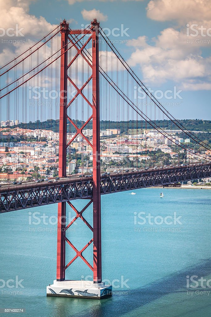 The 25 de Abril Bridge is a bridge connecting stock photo