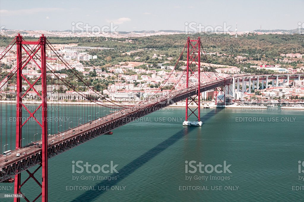 The 25 de Abril Bridge over Tagus in Lisbon stock photo