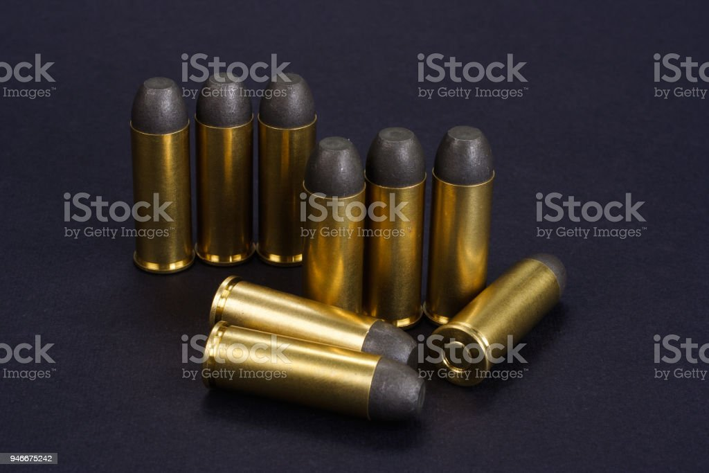 The .45 Revolver cartridges Wild West period on black background stock photo