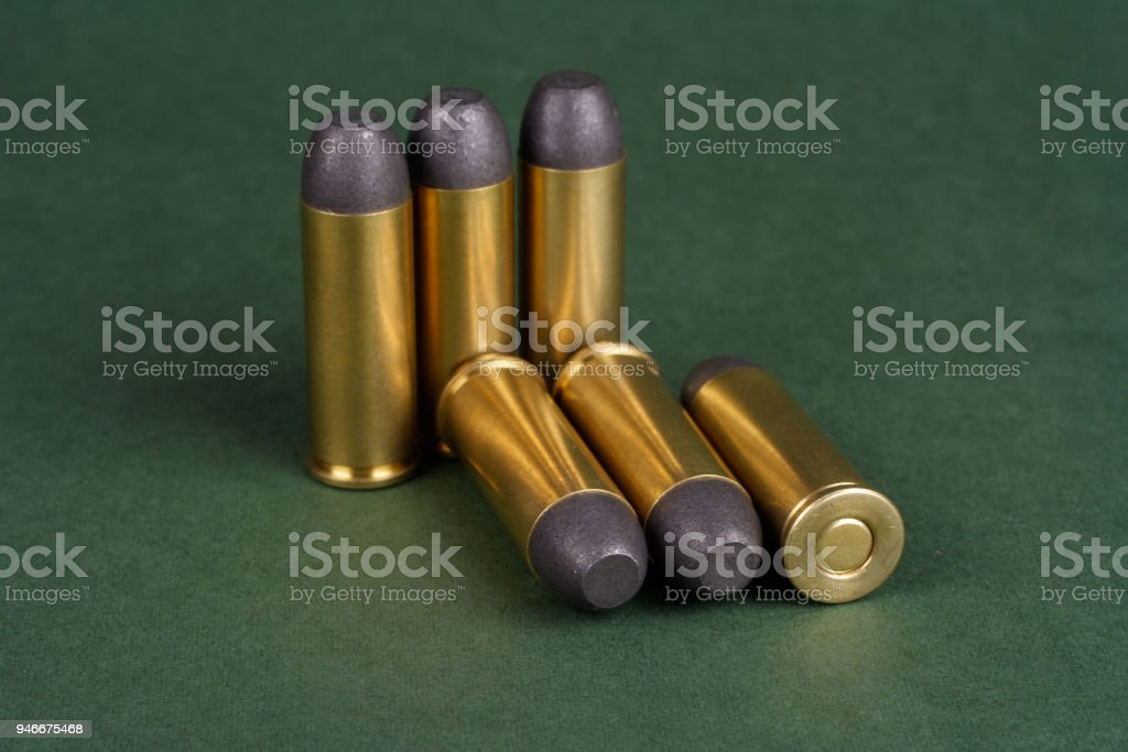 The .45 Revolver cartridges Wild West period on green background stock photo