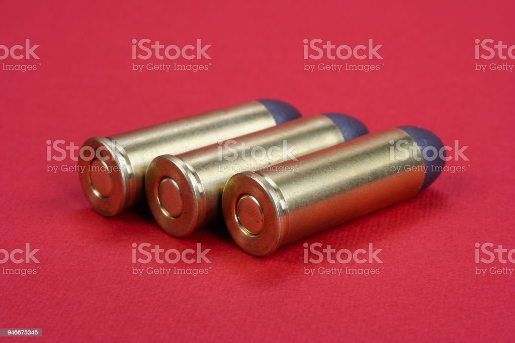 The .45 Revolver cartridges Wild West period on  red background stock photo