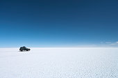 """""""Salar de Uyuni (or Salar de Tunupa) is the world's largest salt flat at 10,582 square kilometers (4,086 sq mi). It is located  in the Potosi and Oruro departments in southwest Bolivia, near the crest of the Andes, and is elevated 3,656 meters (11,995  ft) above the mean sea level. The Salar was formed as a result of transformations between several prehistoric lakes. It is  covered by a few meters of salt crust, which has an extraordinary flatness with the average altitude variations within one  meter over the entire area of the Salar. The crust serves as a source of salt and covers a pool of brine, which is  exceptionally rich in lithium. It contains 50 to 70% of the world's lithium reserves, which has yet to be extracted. The  large area, clear skies and exceptional surface flatness make the Salar an ideal object for calibrating the altimeters of the  Earth observation satellites. The Salar serves as the major transport route across the Bolivian Altiplano  and is a major  breeding ground for several species of pink flamingos."""""""