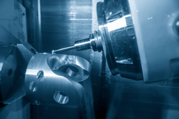 The 5 axis CNC machine cutting the automotive part stock photo