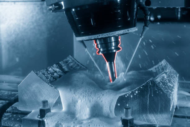 The  5-axis CNC machine cutting the tire mold part. stock photo