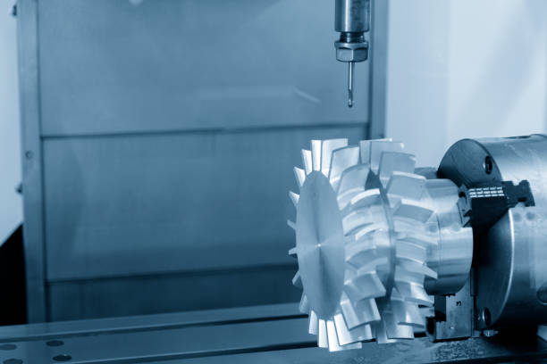 The 5-axis CNC machining center cutting the turbine  part. stock photo