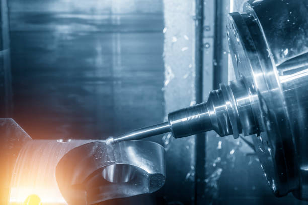 The 5-axis CNC milling machine or machining center cutting the automotive part with the solid ball endmill tool stock photo