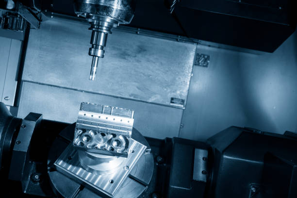 The 5-axis CNC milling machine or machining center cutting the automotive part stock photo