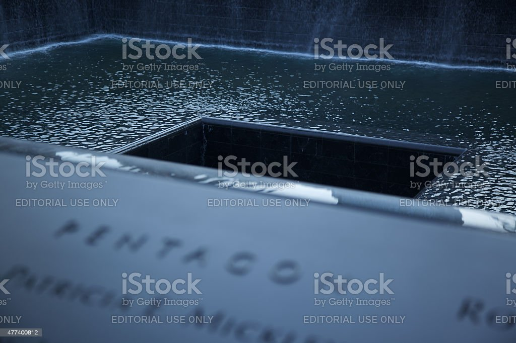 The 9/11 Memorial in New York with blurred foreground stock photo
