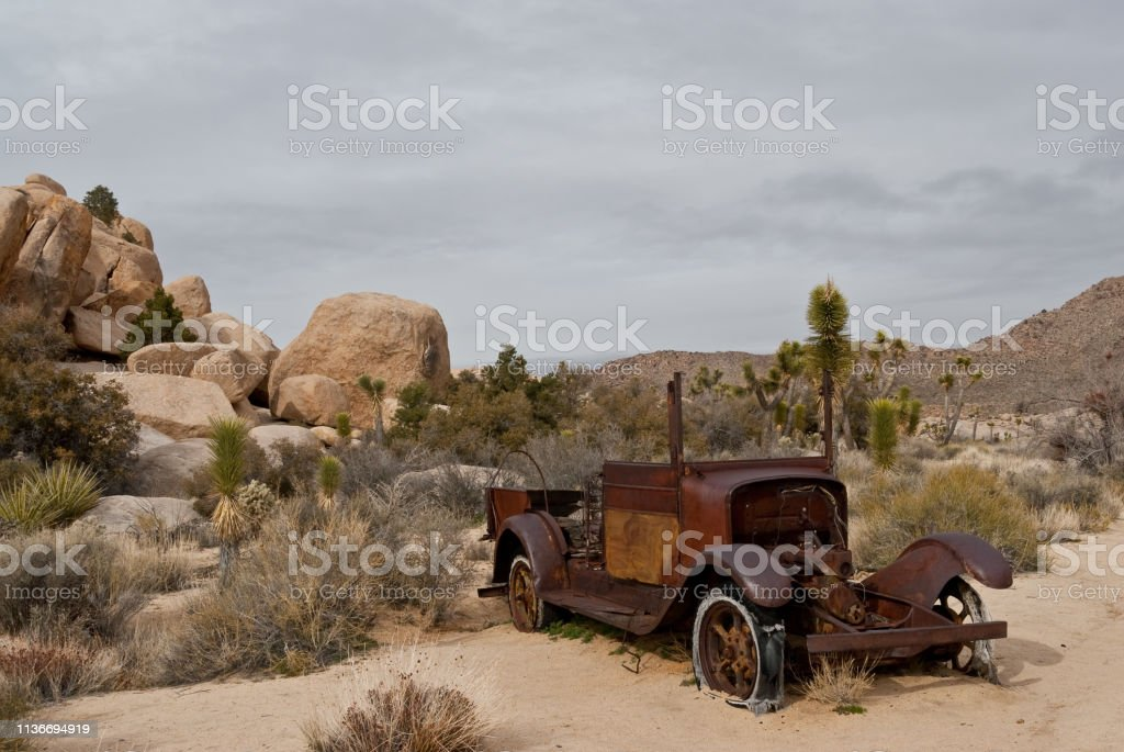 Abandoned Automobile in the Desert stock photo