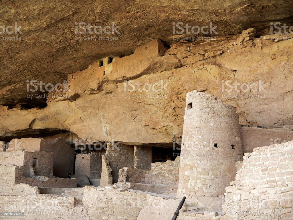 The abandoned dwellings under the cliff ceiling stock photo