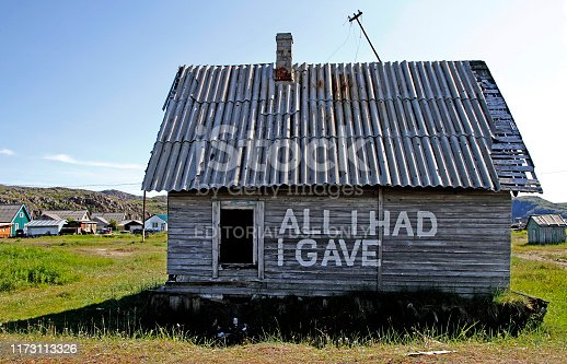 Teriberka, Russia - July 24, 2019: the abandoned house in village of Teriberka on the shore of the Barents sea in the north of Russia