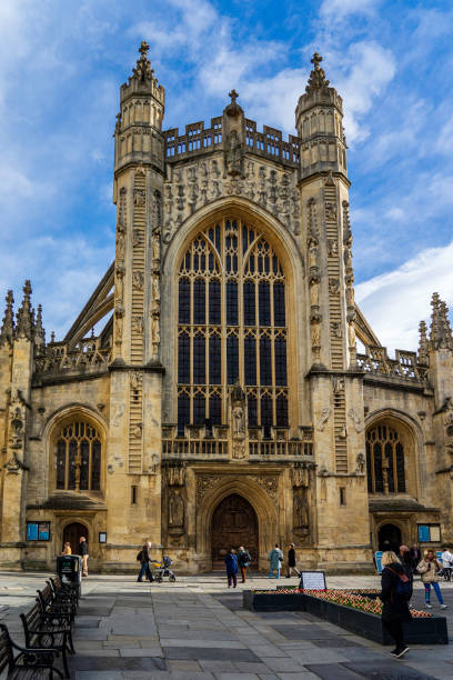 The Abbey at Bath, England Bath, United Kingdom - November 12, 2019: Founded in the 7th century, the Bath Abbey is now part of the Church of England and an architectural and historic landmark of the area, attracting visitors from around the world. bath abbey stock pictures, royalty-free photos & images