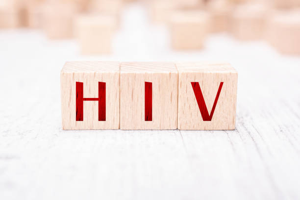 The Abbreviation HIV Formed By Wooden Blocks On A White Table The Abbreviation HIV Formed By Wooden Blocks On White Table hiv stock pictures, royalty-free photos & images