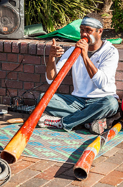 the aborigene musician - didgeridoo stock photos and pictures