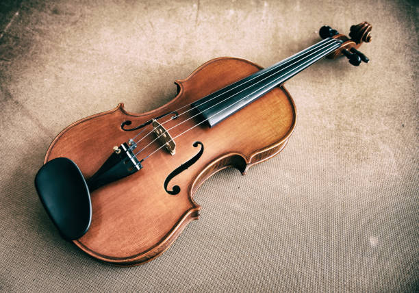 the abstract art deign background of classic violin put on wooden board,vintage and art tone - deign stock pictures, royalty-free photos & images