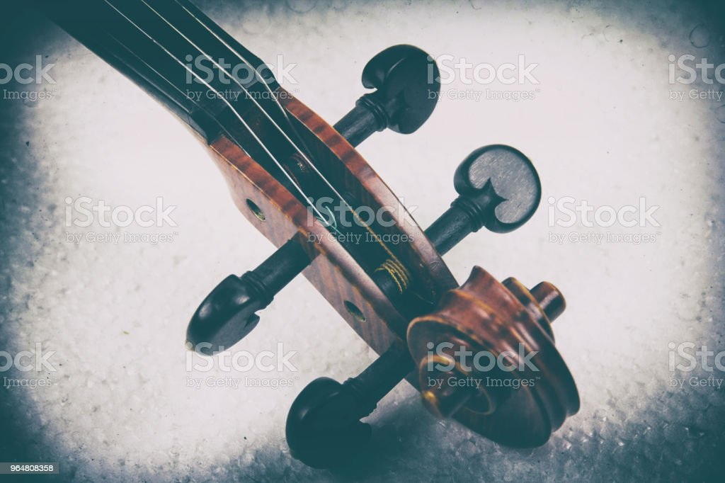 The abstract art design background of the construction of violin,Scroll,Pegbox and neck,in dramatic and grainy film tone,vintage and art style,blurry light around. royalty-free stock photo