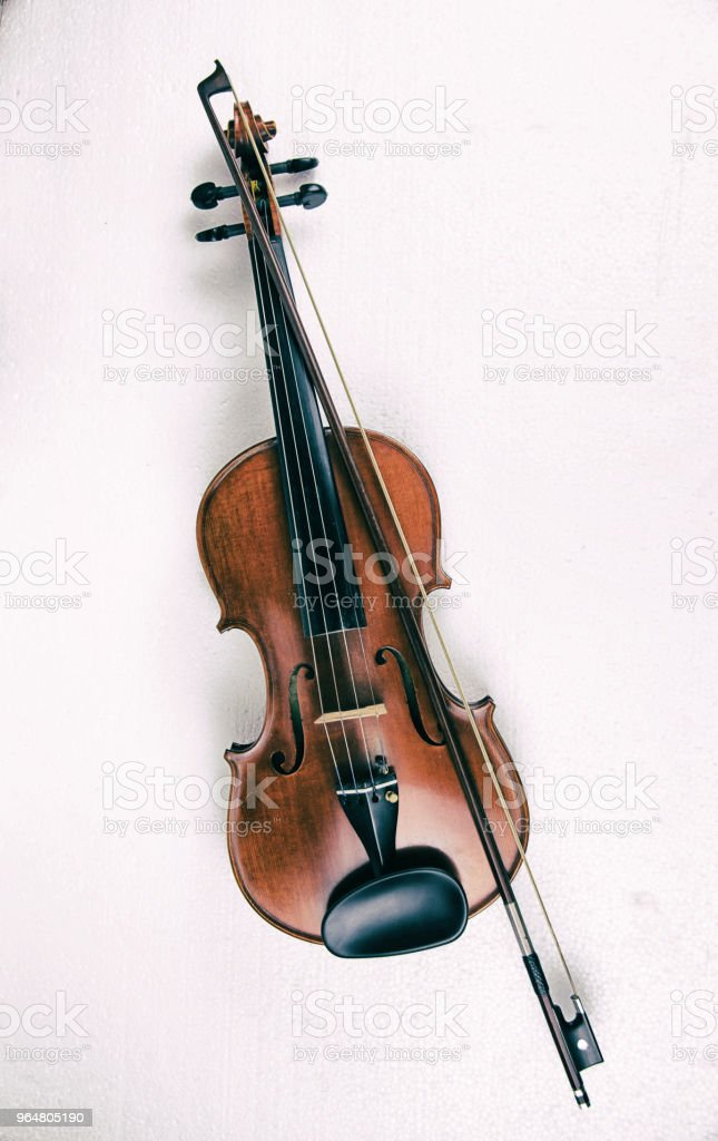 The abstract art design background of wooden violin and bow ,put on white background,in dramatic tone,show body of violin. royalty-free stock photo