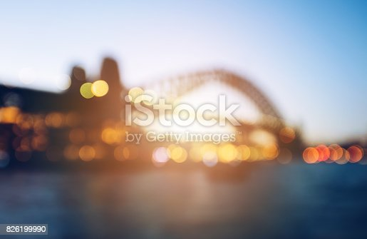 istock The abstract blurred background (defocus) of Sydney Harbour bridge during the sunset. 826199990