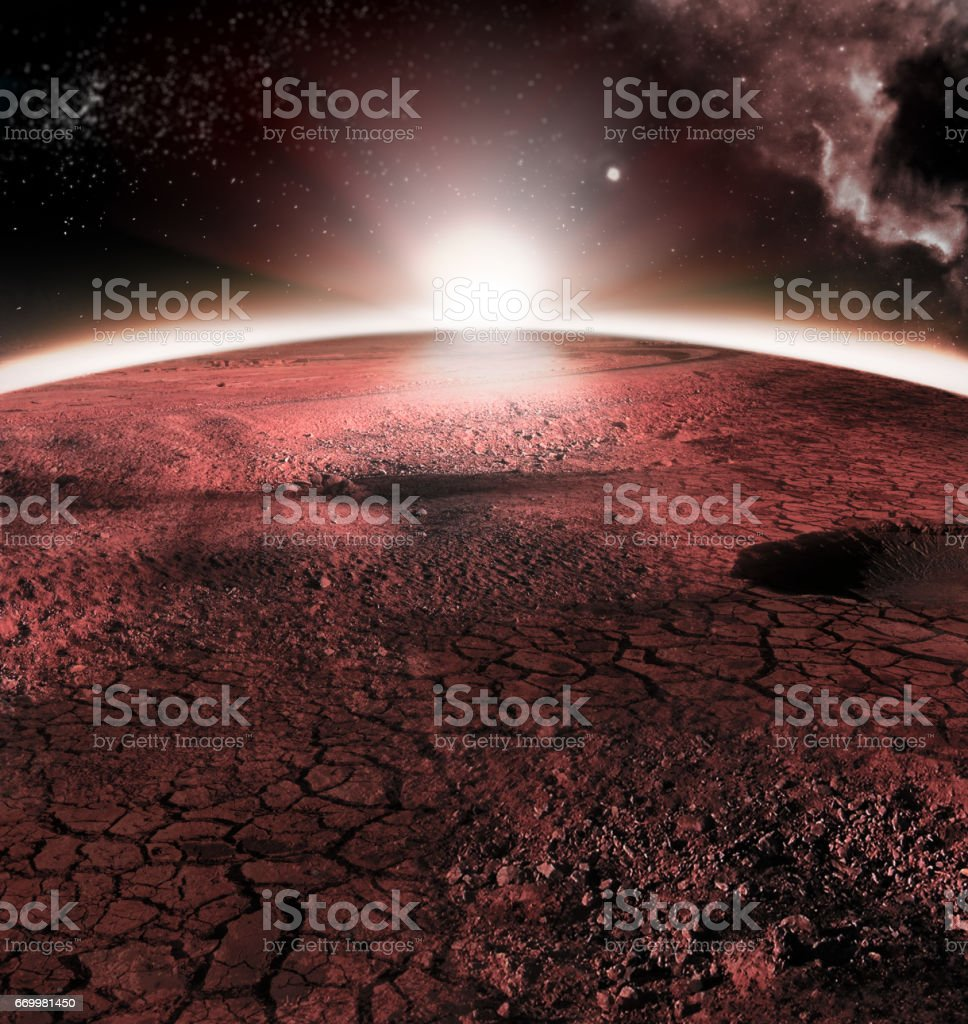 The abstract red landscape of Mars planet. Looks like cold desert on Mars. A huge field of ice stock photo