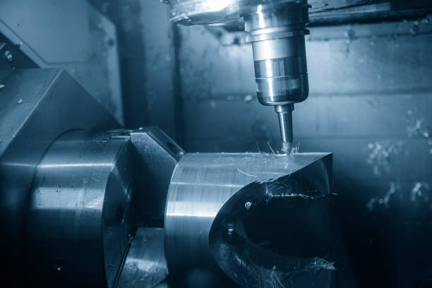 The abstract scene of  5-axis CNC Machining center cutting the turbine  part. stock photo