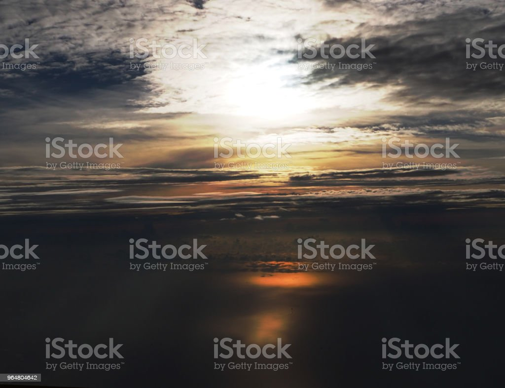 The abstract sky background before sunrise,glamour glow tone from reflection from sunlight pass throung smoky cloud,blurred light waving cloud,vintage and art style,beautiful top view,beauty by nature. royalty-free stock photo