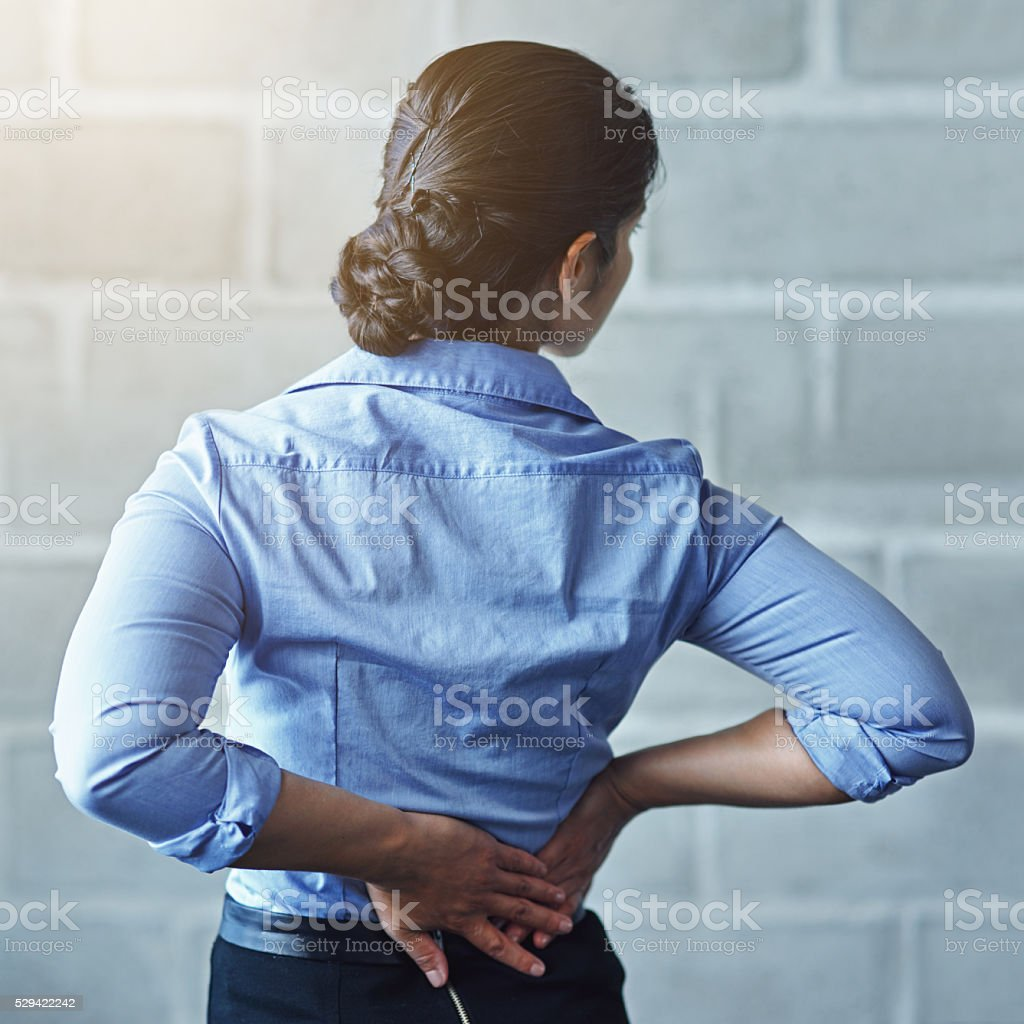 The aches and pains of a long work day stock photo