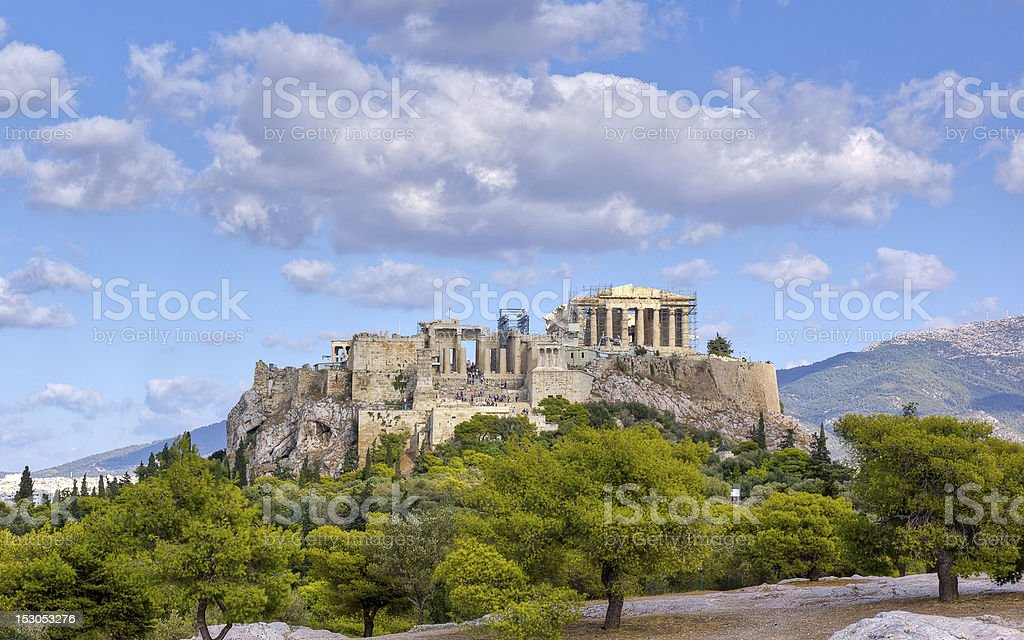 The Acropolis Athens Greece against landscape and cloudy sky stock photo