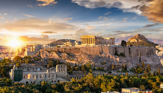 The Acropolis of Athens, Greece, with the Parthenon Temple on top of the hill during a summer sunset