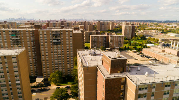 The aerial drone view of the residential district with multi-level social buildings in Brooklyn, New York, along Pennsylvania Avenue stock photo