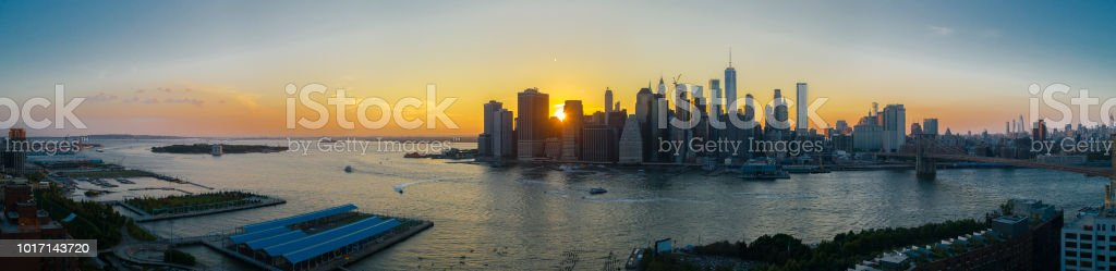 The aerial scenic panoramic view to Manhattan Downtown from Brooklyn Heights over the East River at the sunset. stock photo