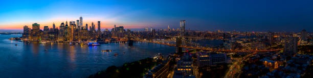 the aerial scenic panoramic view to manhattan downtown from brooklyn heights over the east river at the sunset. - lower east side manhattan stock pictures, royalty-free photos & images
